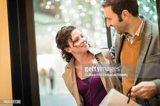 Couple walking on city street : Stock Photo