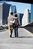 Couple walking on footbridge (rear view), New York City, New York, USA