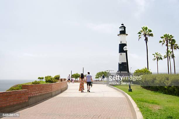 Couple walking on the boardwalk on Lima. Peru
