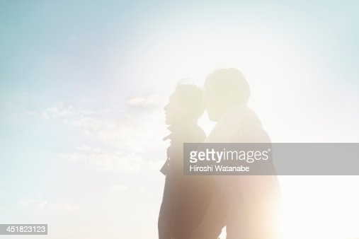 Couple walking on the pavement at sunset