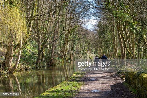 Couple walking on the peak forest canal, Romiley