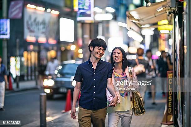 Couple walking on the streets of tokyo