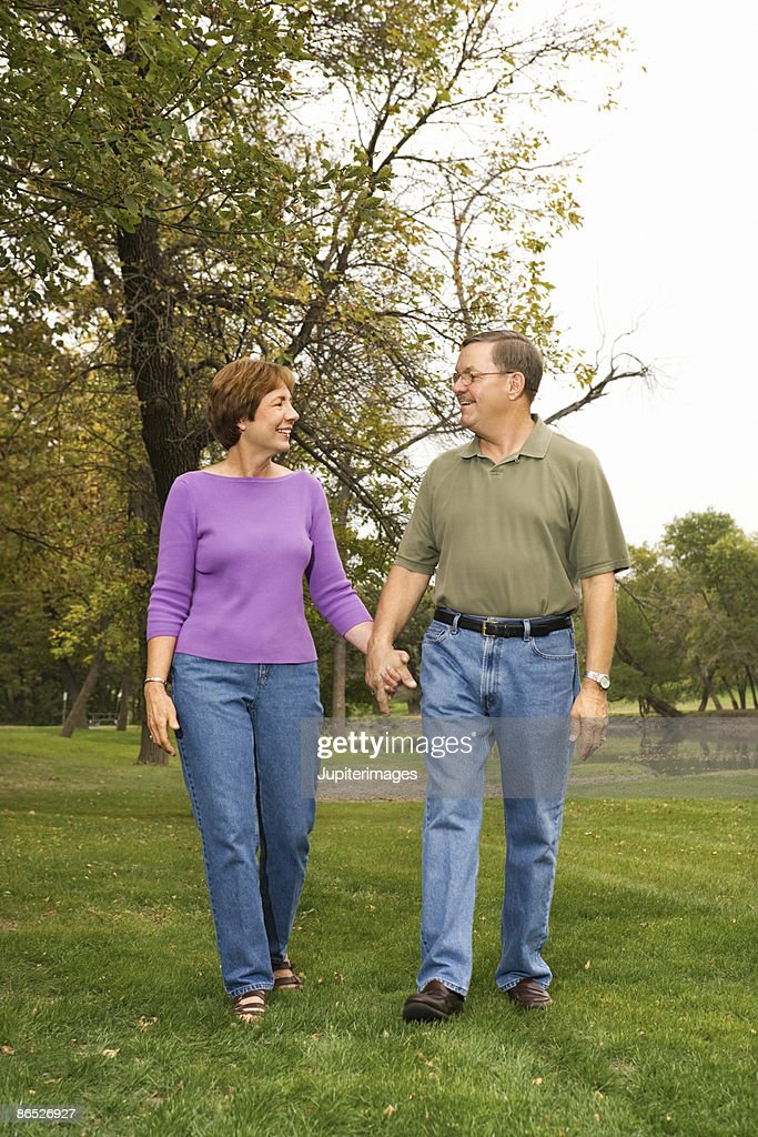 Couple walking outdoors : Stock Photo