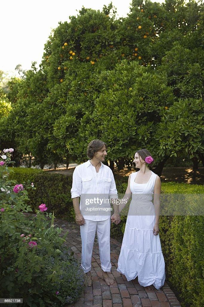 Couple walking through a garden stock photo getty images - When you walk through the garden ...