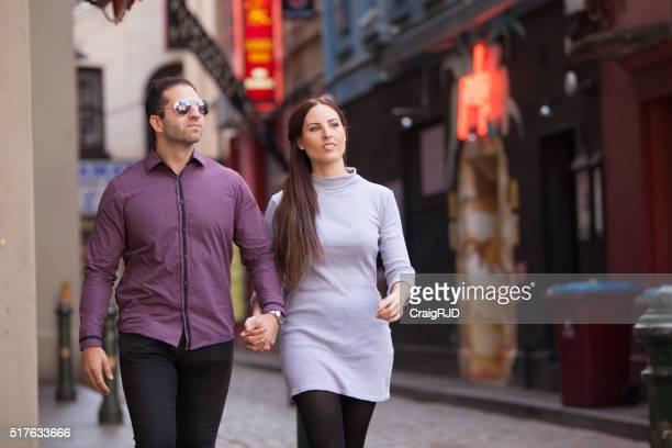 Couple Walking Through Chinatown