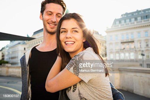 Couple walking through city.
