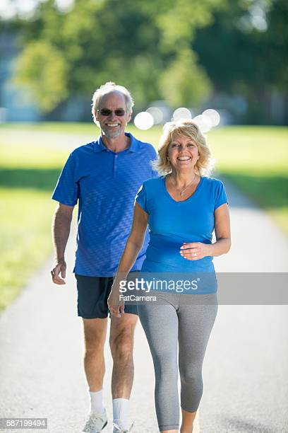 Couple Walking Through the Park