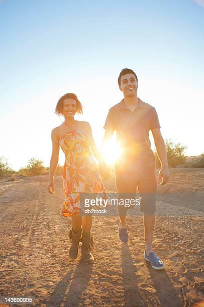 Couple walking together in desert