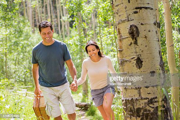 Couple walking together in forest