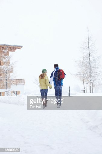 Couple walking together in snow