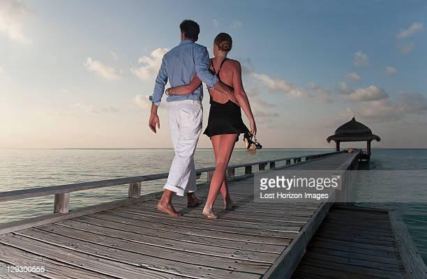 Couple walking together on dock