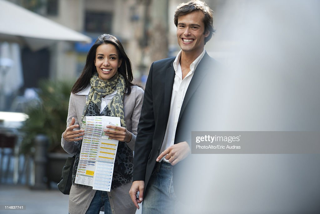 Couple walking together outdoors, portrait