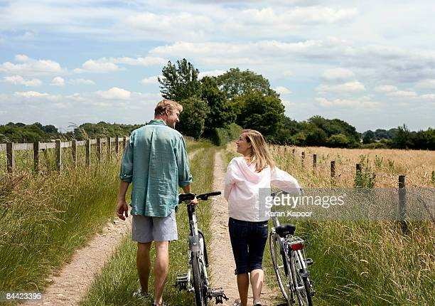 Couple walking with cycles