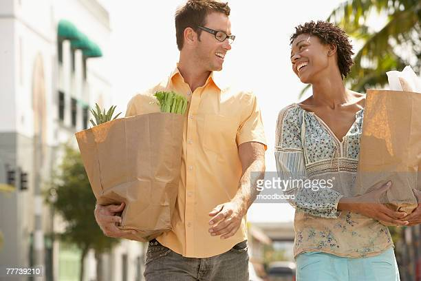 Couple Walking with Groceries in Hand