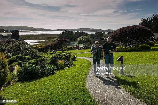 A couple walks along a pathway at the Bodega Bay Lodge near Sonoma County's Doran Regional Park beach on April 23 in Bodega Bay California Warm sunny...