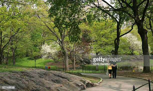 A couple walks arminarm down a pathway in Central Park May 2 2005 in New York City In recent months US Department of Agriculture Forest Service...