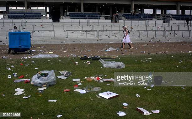 A couple walks away as the littered grounds show the aftermath of picnics at the Royal Ascot After over a decade of Labour Government in Great...