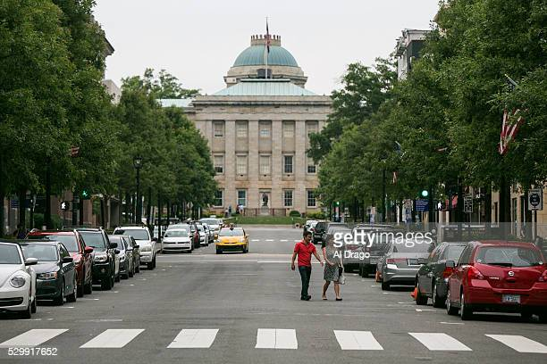 STATES MAY 9 A couple walks near the North Carolina State Capitol on Fayetteville Street in Raleigh NC on Monday May 9 2016 Gov Pat McCrory and his...