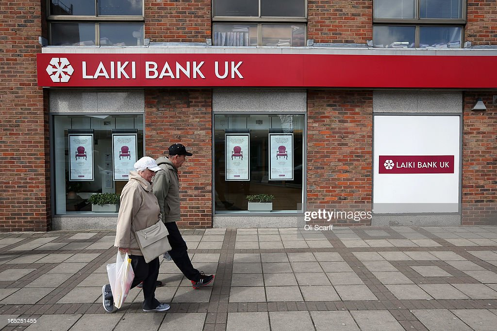 A couple walks past a branch of Laiki Bank UK, a subsiduary of Cyprus Popular Bank, on April 2, 2013 in London, England. Customers with funds in Laiki Bank UK will not face a levy on their accounts, which is being imposed in Cyprus on deposits of over 100,000 Euros as part of the European Union's bail-out package for the Cypriot economy. The Bank of England's Prudential Regulation Authority has announced that all deposits in Laiki Bank UK will be automatically transferred to Bank of Cyprus in the UK.