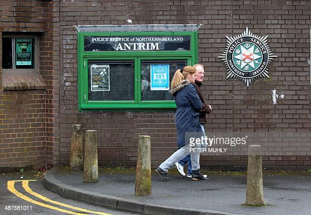A couple walks past the Antrim police station in Antrim Northern Ireland on May 1 where Irish republican leader Gerry Adams head of the Sinn Fein...