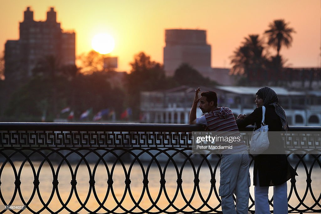 A couple watch the sun set over the Nile on May 29, 2011 in Cairo, Egypt. Protests in January and February brought an end to 30 years of autocratic rule by President Hosni Mubarak, who will now face trial. Food prices have doubled and youth unemployment stands at 30%. Tourism is yet to return to pre-uprising levels.