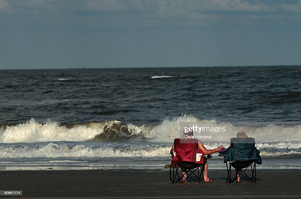 A couple watches the waves crash against the beach from chairs September 3 2008 in Tybee Island Georgia Hurricane Hanna poses a potential threat to...