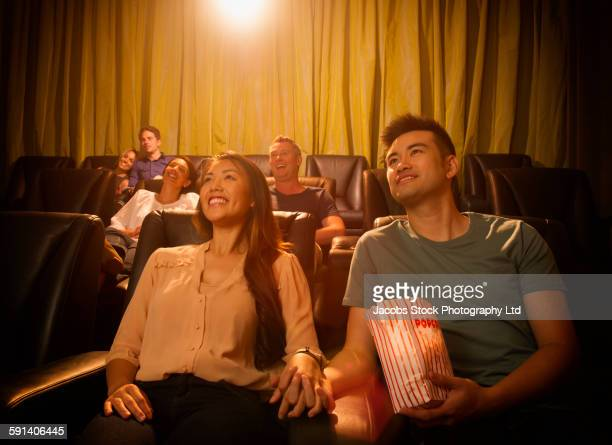 Couple watching film in movie theater