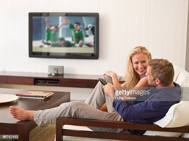 Couple watching football on TV