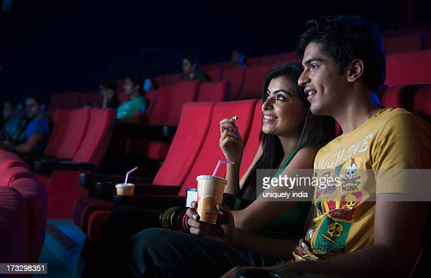 Couple watching movie in a cinema hall