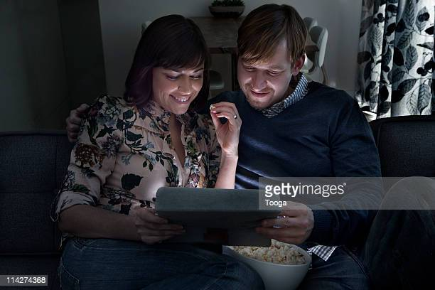 Couple watching movie on digital tablet
