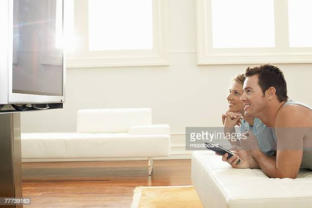 Couple Watching Plasma TV Together