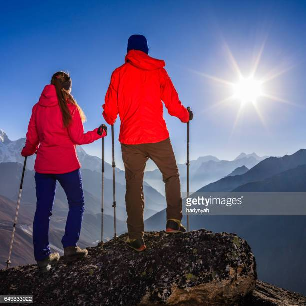Couple watching sunset in Himalayas, Mount Everest National Park