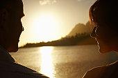 Couple Watching Sunset over Lake