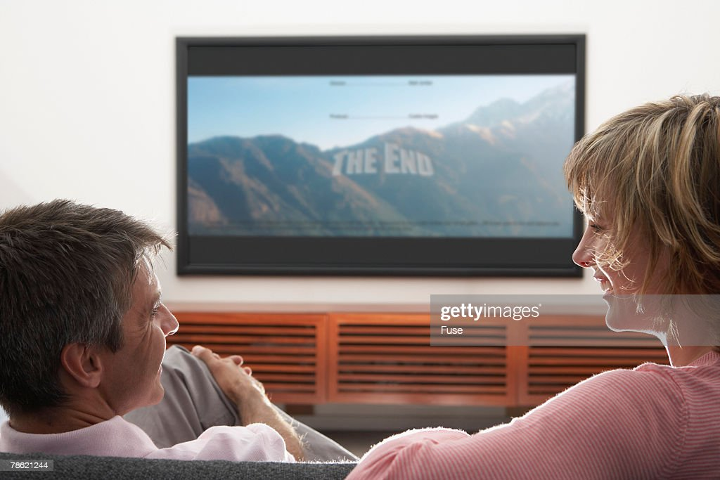 Couple watching television stock photo getty images for People watching