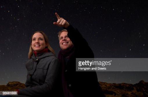 couple watching the starry night sky : Stock Photo