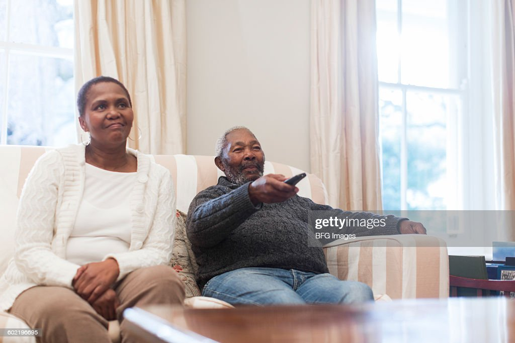 Couple Watching TV In Living Room Cape Town South Africa Stock Photo