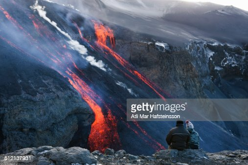 Couple watching volcanic lava, Fimmvorduhals, Iceland