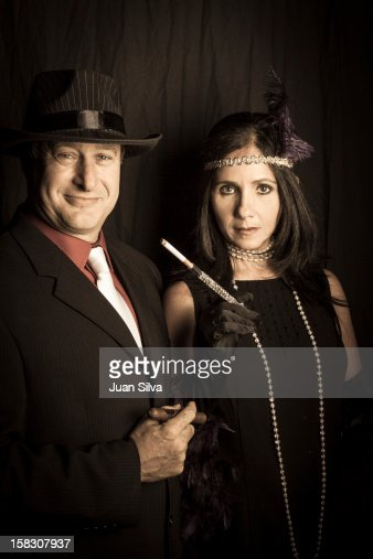 Couple wearing 1920s costumes in a party : Stock Photo