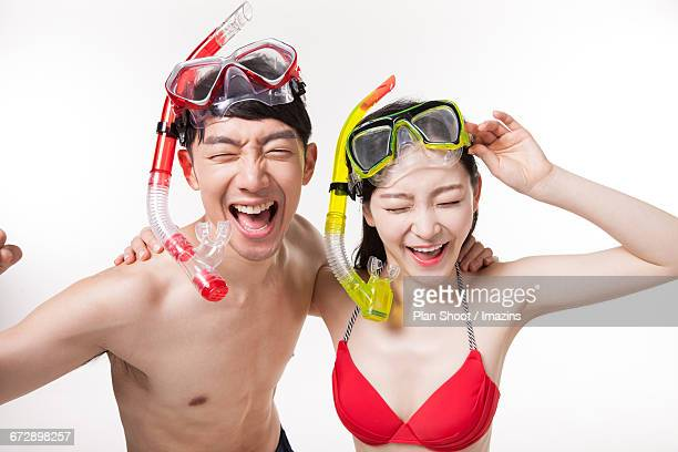 A couple wearing a snorkeling mask
