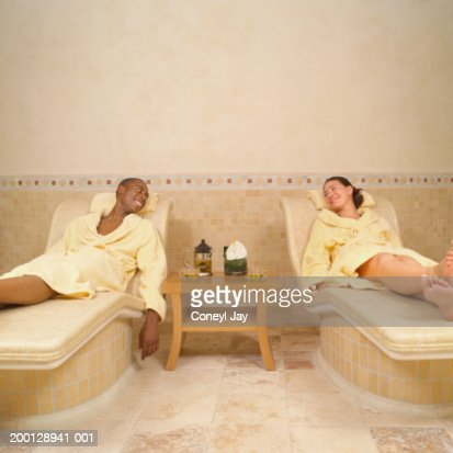 Couple wearing bathrobes, relaxing in spa