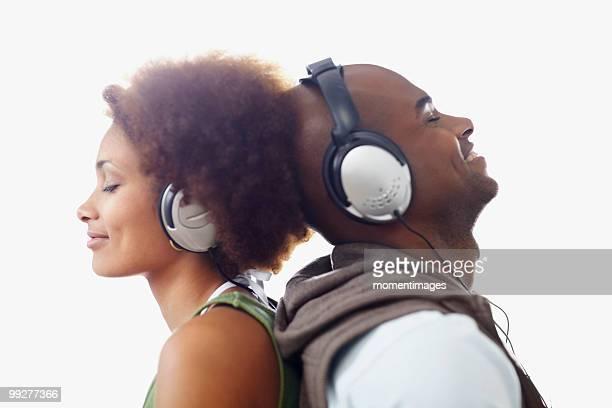 Couple wearing headphones