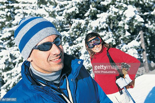 Couple Wearing Skiwear and Sunglasses Standing on Ski Slope