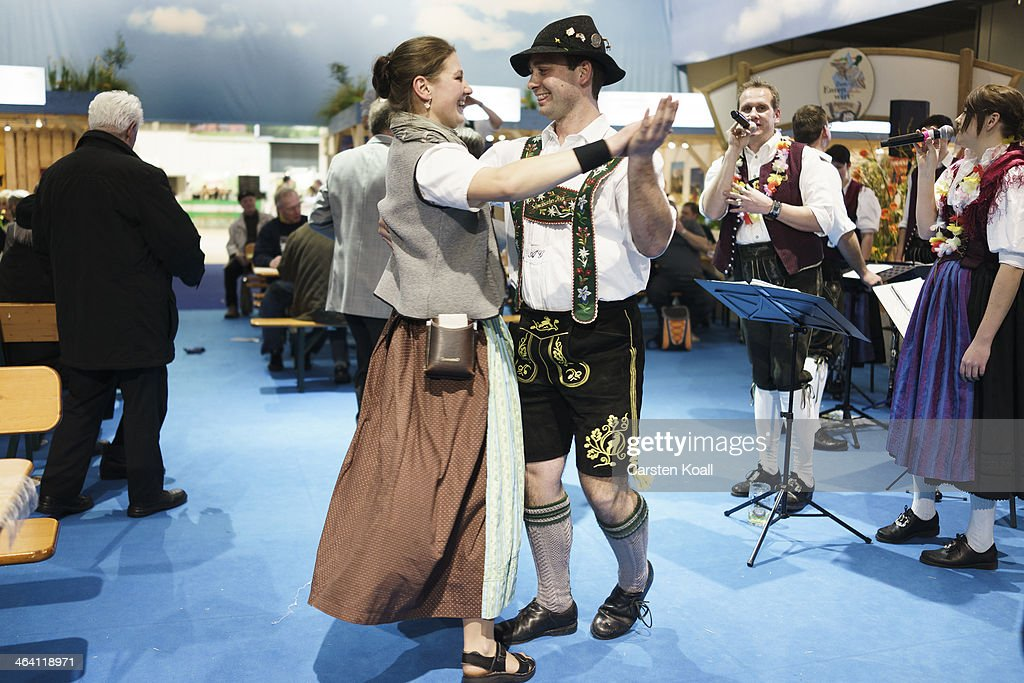 A couple wearing traditional costume dancing together in the exhibition hall of Bavaria at the Gruene Woche agricultural trade fair on January 20, 2014 in Berlin, Germany. The Gruene Woche is the world's largest agricultural trade fair and is open to the public until January 26.
