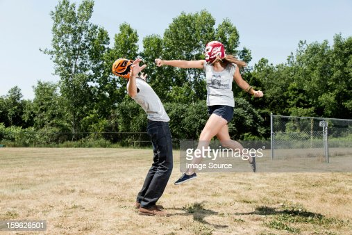 Couple wearing wrestling masks play fighting : Stock Photo