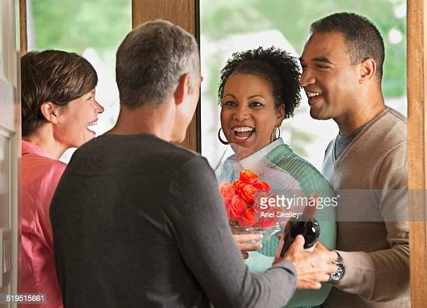Couple welcoming friends