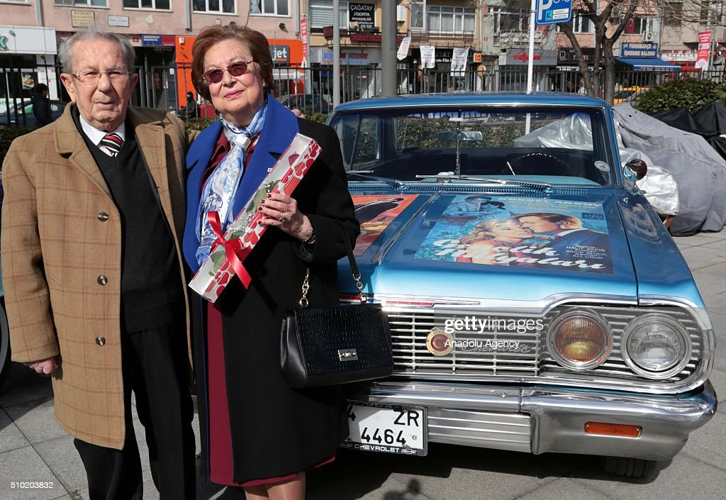 A couple, who has been married for 50 years, looks on in front of a classic car during the 'Half century old loves' event organized by Kadikoy Municipality and Istanbul Classic Car Drives Foundation, in Istanbul, Turkey on February 14, 2016.