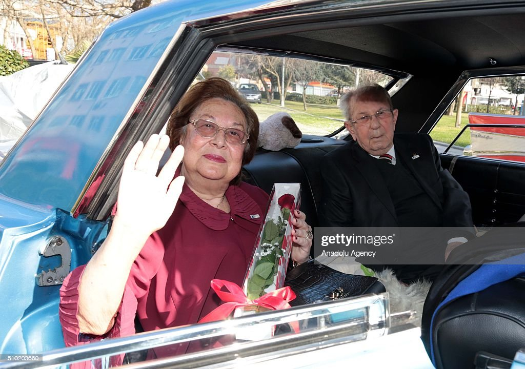 A couple, who has been married for 50 years, waves a greeting inside a classic car during the 'Half century old loves' event organized by Kadikoy Municipality and Istanbul Classic Car Drives Foundation, in Istanbul, Turkey on February 14, 2016.