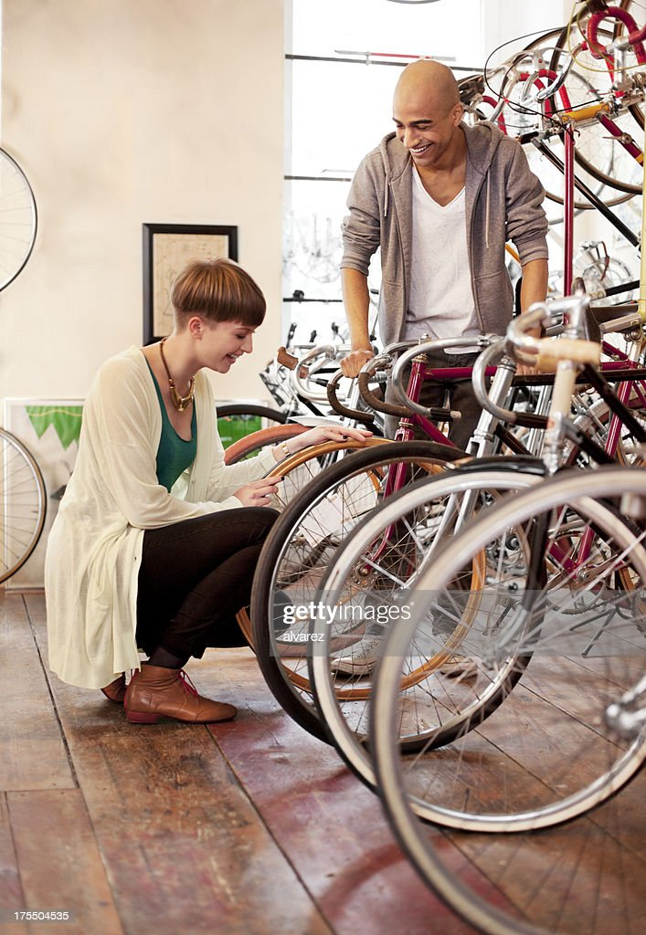 Couple who just purchased a new bicycle : Stock Photo