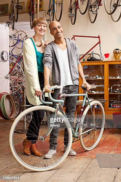 Couple who just purchased a new bicycle