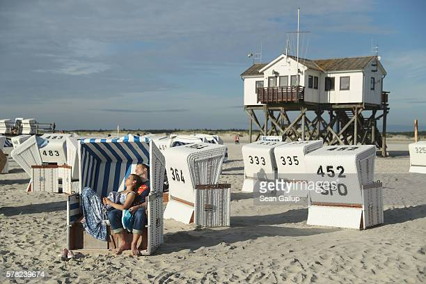 A couple who said they did not mind being photographed relax in a beach chair at the beach on July 18 2016 at SanktPeterOrding Germany...